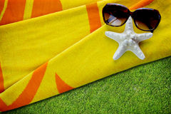Summertime towel with sunglasses Royalty Free Stock Images