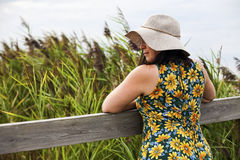 Summertime woman in florall sundress and hat Royalty Free Stock Image