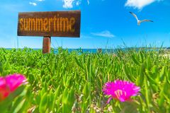 Summertime written on a wooden sign Royalty Free Stock Photos