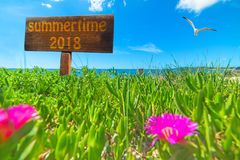 Summertime 2018 written on a wooden sign Stock Image