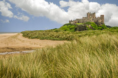 Summery Bamburgh Castle in Northumberland England. With beach Stock Images