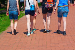 Summery clothed tourists walking. On a footpath Stock Photos
