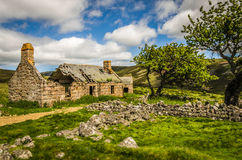 Summery old abandoned Glenfenzie farmhouse ruin in scotland Royalty Free Stock Images