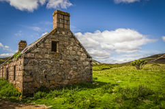 Summery old abandoned Glenfenzie farmhouse ruin in scotland Royalty Free Stock Photos