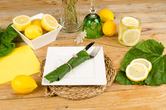Summery party table. Still life of a rustic table set up in summery colors Royalty Free Stock Photo