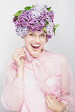 Summery picture. Girl with flowers and a big smile Royalty Free Stock Image