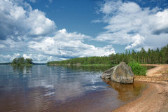 Summery view of the beach in lake Kallavesi Stock Image
