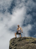 Summit. A male climber on the rocky summit Stock Photography