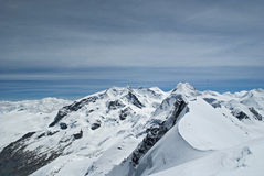 On the summit. View of monte rosa from the summit of western breithorn Stock Photos