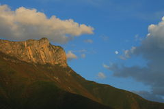 Summit of beautiful Gemu holy mountain and moon in evening clouds, Yunnan, China.  Royalty Free Stock Image