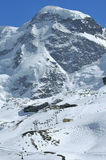 Summit of the Breithorn. The summit of the Breithorn looms over ski runs in the Swiss alps above Zermatt Royalty Free Stock Photography