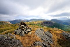 Viewing the ridge to Steel Fell from Calf Crag. The summit cairn of Gibson Knott stock photo