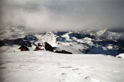 The Summit Cap. Of Mount Rainier looking down the Emmons Glacier as clouds pulse above Stock Photo