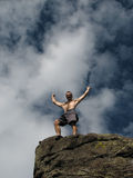 Summit celebration. A male climber celebrates reaching the summit Stock Photos