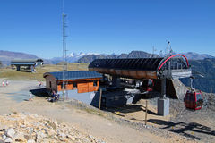 Summit of Chamrousse, landscape and cable car. CHAMROUSSE, FRANCE, August 26, 2015 : A cable car with small cabins joins the ski resort of Chamrousse -  Le Stock Photo