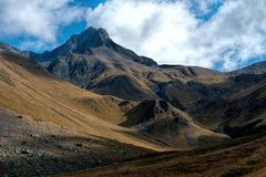 Summit in the clouds and the narrow gorge royalty free stock images