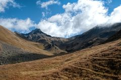 Summit in the clouds and the narrow gorge royalty free stock image