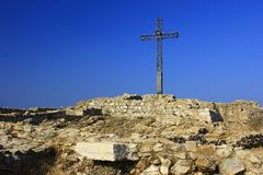 Summit Cross. At the Rocca di Manerba, Manerba del Garda, Lake Garda, Italy - in the foreground remains of the former castle Stock Photo