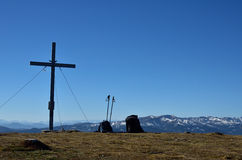 Summit cross with backpacks next to it. In the Austrian alps Stock Photography