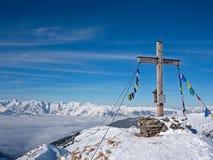Summit cross in front Alpine landscape Stock Photo