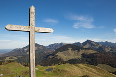 Summit Cross in Front of Panorama of European Alps Stock Image