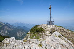 Summit cross at Hochfelln. Summit cross in the Bavarian Alps Royalty Free Stock Photography