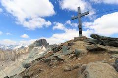 Summit cross on mountain Saulkopf and glacier panorama, Hohe Tauern Alps, Austria Royalty Free Stock Photography