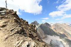 Summit cross on mountain Saulkopf and glacier panorama, Hohe Tauern Alps, Austria Royalty Free Stock Photos