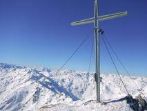 Summit cross in winter austrian alps Royalty Free Stock Photography