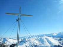 Summit cross in winter austrian alps Royalty Free Stock Image