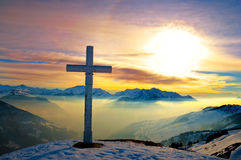 Summit at dusk. A cross at the top of a mountain at dusk Stock Image