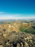 Summit of Grays. This photo was taken from the summit of Grays Peak and features a view of Torrey's Peak and clouds in the distance below Stock Photo