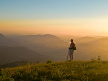 Summit hiker. A female hiker revels in a scenic summit accomplishment Stock Photo