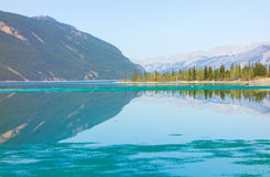 Summit  lake melting in the early spring sunshine Royalty Free Stock Photo