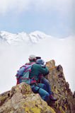 Summit love. Couple on the top of the Aiguille de L'Index, nearby Chamonix. In the background the Mont Blanc Stock Photography
