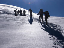 Summit march. The slow plod of a group attempting to summit at over 12,000 feet Stock Photos