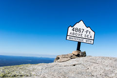 Summit marker on Whiteface Mountain in the Adirondacks of Upstate NY. Whiteface Mountain is one of the highest mountains in the Adirondacks at 4,867 feet Stock Photos
