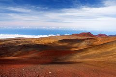 The summit of Mauna Kea, a dormant volcano on the island of Hawaii. Stunningly beautiful red stone peak hovering above clouds, the. Highest point in the state Royalty Free Stock Images