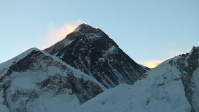 Summit of Mount Everest just before sunrise. View of the summit of Mount Everest in Nepal, also known as Sagarmatha or Chomolungma, from the slope of Mount Kala stock video