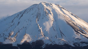 The summit of Mount Fuji covered with snow, a world heritage in Japan Royalty Free Stock Photo