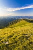 The summit of Mount Pratomagno (Italy). The summit of Mount Pratomagno in Tuscany (Italy). A particular mountain whose peak is constituted by a large lawn area Stock Photos