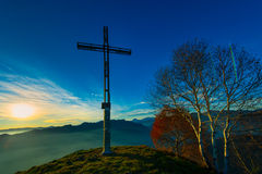 Summit of a mountain with cross Royalty Free Stock Images