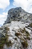 Summit of Ostry Rohac peak in Western Tatras mountains in Slovakia. Summit of Ostry Rohac peak in Rohace mountain group in Western Tatras mountains in Slovakia royalty free stock images