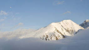 Summit over the clouds. Snowed peak over the clouds from Envalira Pass, Pas de la Casa, Andorra Royalty Free Stock Photo