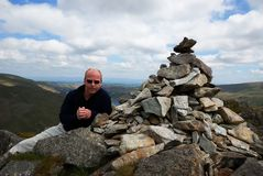 At the Summit. Proof you made the top - at the Summit Cairn Stock Photos