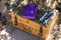 Closed Wooden Prayer Box with Pencils Symbol Love Religion Concept. Summit Register in form of Prayer Box on Iron Mountain Peak, Poway, San Diego County North royalty free stock photo