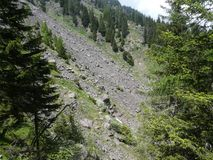 Summit rock panorama landscap of the mountains in italy south tyrol europe. Europe italy south tyrol mountains summit rock trees forest nature forest trees royalty free stock photo