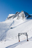 Summit and ski slope in alps Stock Photo