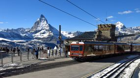 Summit station Gornergrat and Matterhorn. Trainstation on the Gornergrat in Zermatt royalty free stock photography