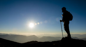 Summit success silhouette. Crazy adventurous and climber.Discovery and adventure royalty free stock image